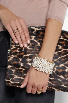 Handmade  Gold-dipped brass Pearls Magnetic clasp fastening  Comes in a tie-fastening pouch