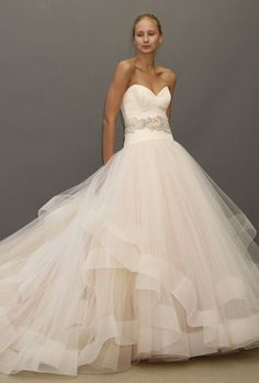 Lazaro strapless blush satin and organza ball gown wedding dress with a sweetheart neckline and beaded belt