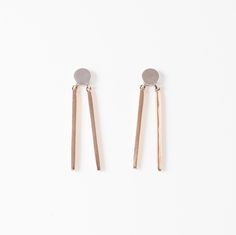 Double stick earrings with silver circle and bronze legs. On sterling  silver…