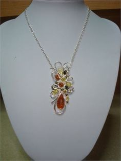 amber baltic flower design pendant in sterling silver 925, at 3 inches tall and 1,5 inches long, it comes with the sterling silver 925 chain at 50 cm long
