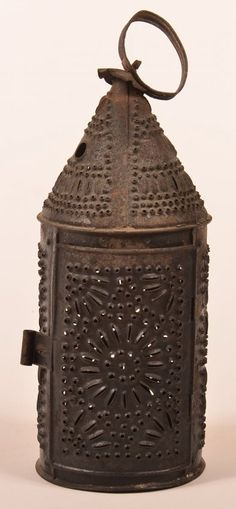 Pennsylvania Punched Tin Candle Lantern my mom gave me one a lot like this :) I love it!