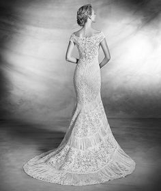"""""""Kaira"""" by Pronovias  Back View  Lace and guipure dress with fringe appliqués on the skirt. Off-the-shoulder neckline with v and sheer back. Romantic wedding dress"""