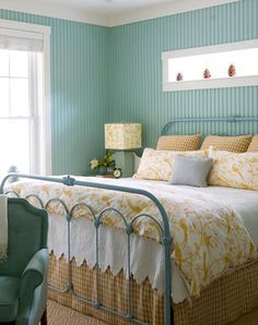 yellow and blue cottage bedroom with wood paneled walls