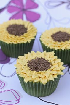 sunflower cupcakes!    this site has great images for cupcakes. baby shower ideas?