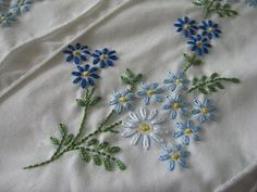 This is the Blue Daisies pattern from Tobin. I think this pattern is just so lovely. I am mostly happy with it, but I don& care for the da. Hand Embroidery Projects, Hand Work Embroidery, Baby Embroidery, Hand Embroidery Designs, Ribbon Embroidery, Cross Stitch Embroidery, Embroidery Patterns, Diy Embroidered Pillow, Embroidered Pillowcases