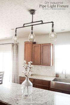 Kitchen Lighting Ideas DIY Industrial Pipe Light Fixture - a beautiful DIY pendant light Industrial Style Lighting, Pipe Lighting, Farmhouse Lighting, Unique Lighting, Lighting Ideas, Pendant Lighting, Cheap Lighting, Table Lighting, Custom Lighting