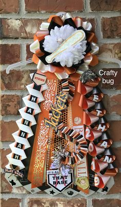 orange black and white homecoming mums Homecoming garter mum Middle school ribbons/ braids); orange black and white homecoming mums Homecoming Mums Senior, Homecoming Garter, Homecoming Dresses, Homecoming Corsage, Senior Year, How To Make Mums, Texas Mums, Floral Design Classes, Ribbon Braids