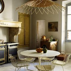 Rustic French kitchen in Atelier Vime's eighteenth-century hôtel particulier uses antiques and rustic Provençal pottery. Kitchen ideas and designs.