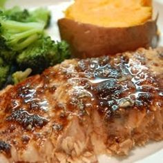 "Balsamic-Glazed Salmon Fillets - ""A glaze featuring balsamic vinegar, garlic, honey, white wine and Dijon mustard makes baked salmon fillets extraordinary"
