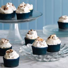 Fluffernutter Cupcakes | Creamy peanut butter and chopped chocolate-covered peanuts top delicious golden cake.