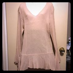 Beautiful light beige crinkle design boutique top Has a design sleeves and bottom has a scallop and a shark bite on sides of top. Length is a 31 to 31 1/2 . 100%polyester. In great shape and has a v neck . Dress U 11 by sharon Tops Tunics