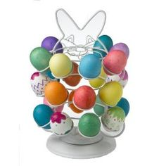 The Nifty Easter Egg Carousel is a unique and fun way to decorate, dry, and display your easter eggs. The carousel has a lazy susan base that will rotate 360-degree, making it an extremely functional piece while you decorate each of your eggs. The carousel will also look great as a decorative center piece, as you can fill it with any type of decorative easter eggs during the easter season. The Easter Egg Carousel will hold up to 24 extra large easter eggs.