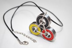 Germany Skateboard Necklace! Awesome necklace made from recycled skateboard bearings featuring Red, Yellow, and Black bearings. German Flag Colorway!   Perfect gift for skateboarders, roller derby skaters, longboarders or anyone! Find it on our Etsy or website.