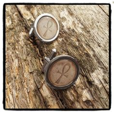 A great gift for adding a touch of the macabre to any formal occasion!   Chrome 20mm cufflinks with an Ancient Ankh image that appears to be embossed into a sandstone background. Capped with a clear dome.  #egyptiancufflinks #ankhcufflinks #ancientegypt