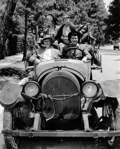 """Remembering honoring Donna Douglas on Tributes.com. """"The cast of TV's """"The Beverly Hillbillies,"""" are seen riding in their car in this May 19, 1967 photo. Seen are Buddy Ebsen, front left, Max Baer, front right, Donna Douglas, rear left, and Irene Ryan. Ebsen, the loose-limbed dancer turned Hollywood actor who achieved stardom and riches in the television series The Beverly Hillbillies and Barnaby Jones, died Sunday, July 6, 2003, at Torrance Memorial Medical Center in Torrance, Calif., a ... Max Baer, Donna Douglas, Bernie Memes, Buddy Ebsen, Tv Theme Songs, The Beverly Hillbillies, Tv Themes, Celebrity Deaths, Comedy Tv"""