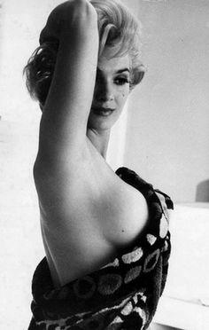 Marilyn Monroe showing a little bit more. In a towel