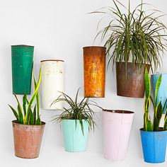 Hang plants in vintage buckets to add life and color to your child's room. (Just place them high enough that kids can't grab the dirt!)