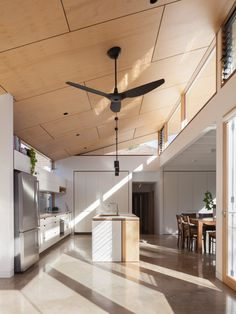 Black and White House by Cantilever Interiors and Ben Callery Architecture | contemporary open-plan kitchen design | polished concrete floors | ply ceiling