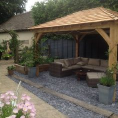 Our stunning Oak Garden Sheds and Gazebos are hand-crafted in Cheshire to improve your outdoor living area. Gazebo Roof, Backyard Gazebo, Backyard Seating, Garden Gazebo, Garden Seating, Backyard Landscaping, Bbq Area Garden, Garden Pavilion, Outdoor Garden Rooms