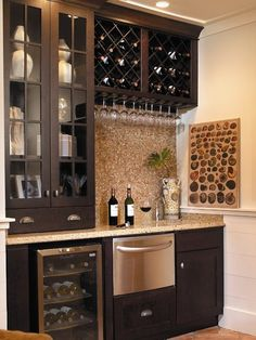 Small, stylish wet bar with tons of storage. This will be in my hidden room.