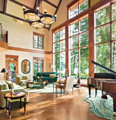 Mexican Alder wood doors with decorative hand-wrought iron, open to this library that boasts a hammered copper ceiling.