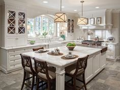 kitchen-island-with-seating-butcher-block-two-tone-kitchen-cabinet-pendant-lighting-white-kitchen-cabinet-black-wood-bar-kitchen-chair-792x594.jpg 792×594 pixels
