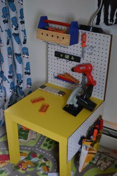 toddler workbench using Target $10 table and cheap pegboard