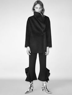 Embracing large proportions, Zara features oversized wrap coat with fared flowing trousers