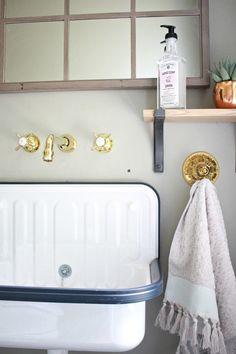 Bathroom remodel featuring Rejuvenation's utilitarian Alape Bucket Sink.