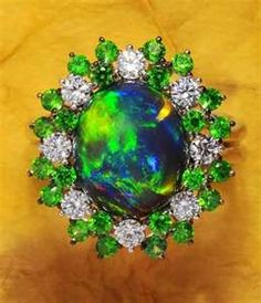 Black opal, emerald and diamond ring