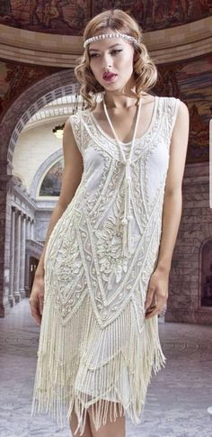 RUSH ORDERS AVAILABLE! PLEASE MESSAGE WITH DATE REQUIRED. PLEASE NOTE USUAL PROCESSING TIME IS 4 WEEKS PLUS SHIPPING TIME. Stunning Ivory Vintage Charleston Flapper 1920s inspired beaded Wedding Dress. Two rows of zig zag fringing framing the hem of this dress, swaying