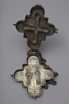 Reliquary Cross Reliquary Cross Date: 13th century Culture: Byzantine or Russian Medium: Silver with traces of gilding, niello, granulated hinge, and a pearl Dimensions: Overall: 5 1/2 x 4 x 11/16 in. (14 x 10.2 x 1.7 cm) Classification: Metalwork-Silver Credit Line: Dom-Museum HIldesheim (DS 3) Not on view This artwork is part of Medieval Treasures from Hildesheim