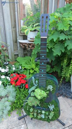 But after finding an abandoned guitar, it was game on! The guitar planter was finally born! Succulent Wall Planter, Succulent Arrangements, Succulents Garden, Guitar Decorations, Diy Planters Outdoor, Planter Ideas, English Cottage Style, Flower Pots, Flowers