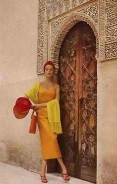 Ah....some backdrops are timeless. Gorgeous Moroccan door & fabulous model. Picture from1953
