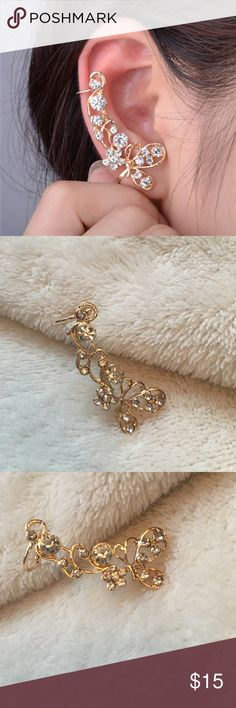 Butterfly Ear Climber Gold alloy hypoallergenic butterfly ear climber. Featuring a single butterfly positioned at the pierced portion of the ear with a floral vine climbing upwards. Adorned with glittering diamond inspired accents. The perfect addition to any outfit, a great piece of fashion jewelry!! Gorgeous!! Jewelry Earrings