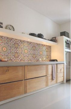 The simple cabinets are very nice. The tile is amazing. Not for this house but amazing!
