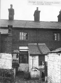 SEV/10/8 Black and white photograph of 73 College Street, St.Helens.c.1930's. shows rear of premises with clothes mangle, dolly tub and wooden posser. Photograph relates to 1936 Clearance Order.SEV - St.Helens Metropolitan Borough Council, Environmental Health Section 10 - Photographs from St.Helens Borough Council, Health, Planning and Sanitary Departments.