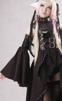 Freya from Chobits wearing her black leather dress.  The buckles make it look punk, but the headband says graceful.