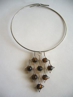Necklace | Kultaseppa Salovaara. Sterling silver and Tiger Eye. ca. 1960s, Finland