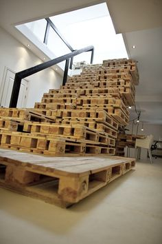 Stairs made of shipping pallettes at BrandBase Office in The Netherlands by MOST Architecture