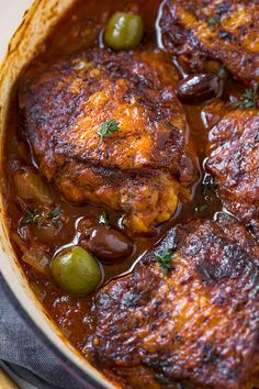 Braised Chicken Thighs: Rustic and saucy, this rich and flavorful braised chicken with tomatoes and olives, plus a tiny hint of white wine, is a simple peasant-style meal finished in the oven to juicy perfection, served with your favorite side. Dutch Oven Recipes, Cooking Recipes, Freezer Cooking, Cooking Tips, Freezer Recipes, Oven Cooking, Freezer Meals, Braised Chicken Thighs, Dutch Oven Chicken Thighs