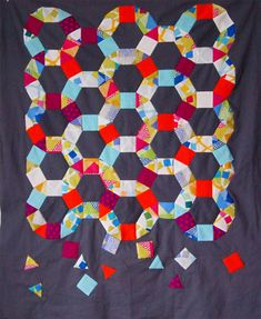 Spring Carnival quilt.  Cool design!  (thelongthread.com)