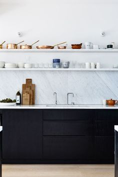 a high-contrast modern black and white kitchen | house tour via coco kelley