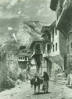 """In the early 20th century, the Bulgarian town of Melnik had a mixed population of Greeks, Bulgarians, Turks, Vlachs and Romani. Melnik is the subject of Yuri Trifonov's short story """"The Smallest Town on Earth"""" (1967)."""