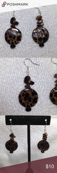 Tiger Eye Sterling Silver Earrings These adorable drop earrings are made with natural tiger eye chips and a leopard spotted shell. The hooks are marked 925 Sterling silver PeaceFrog Jewelry Earrings
