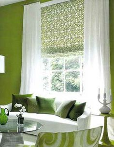 A tailored roman shade would look beautiful with a green ceiling