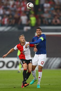 Chris Smalling of Manchester United and Nicolai Jørgensen of Feyenoord in action…