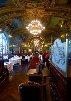 Le Train Bleu restaurant in the Gare de Lyons train station..,Paris. Built the same time as the Grand Palais, Le Petit Palais, and the Alexandre III bridge to celebrate the Universal Exhibition in 1900.  Was hoped the restaurant would attract and impress visitors arriving to attend the Exhibition. Totally over the top gorgeous in that French Belle Epoque way - velvet banquettes, brass work, stained glass, crystal, and decorated with beautiful paintings.