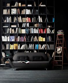 black walls + bookshelf / colorful books