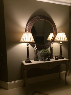 Swirl circular mirror. Walls Farrow and Ball Mouses Back. Lamps ... Wood and brass Crowes Nest